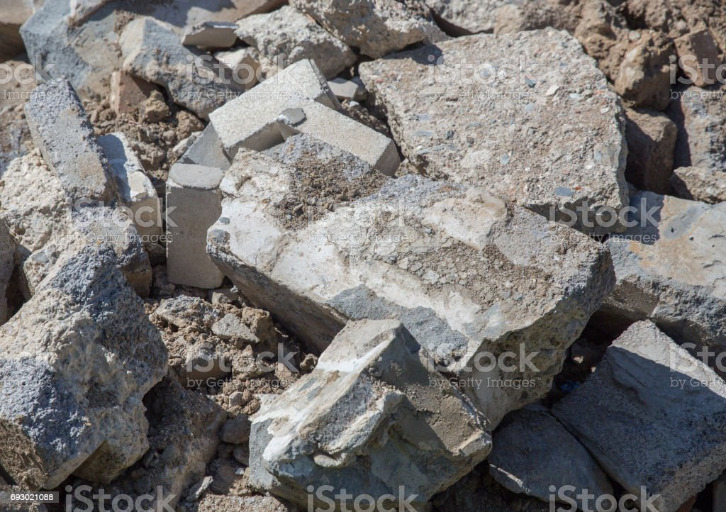 Piles of broken reinforced concrete from a foundation broken out