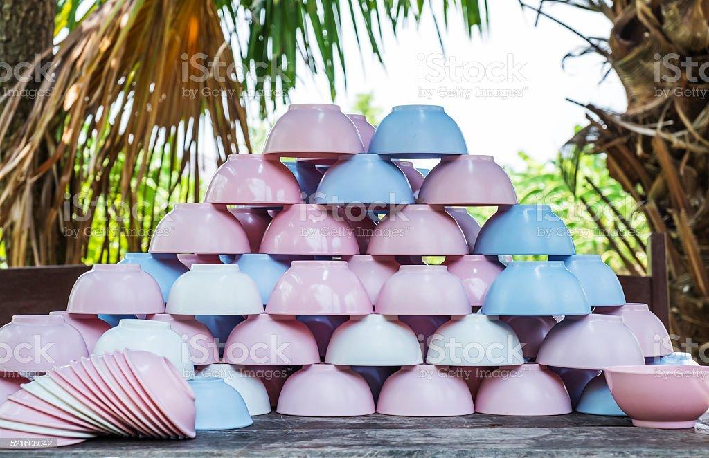 Piles of colorful plastic crockery bowl stock photo