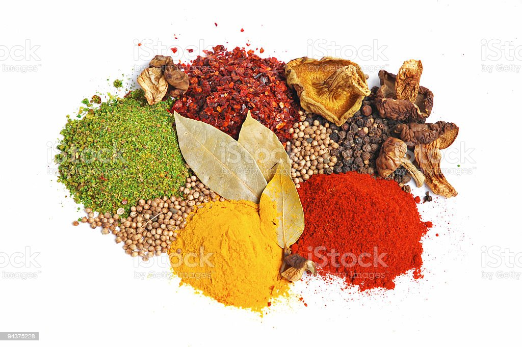 Piles of colorful spices on white background royalty-free stock photo