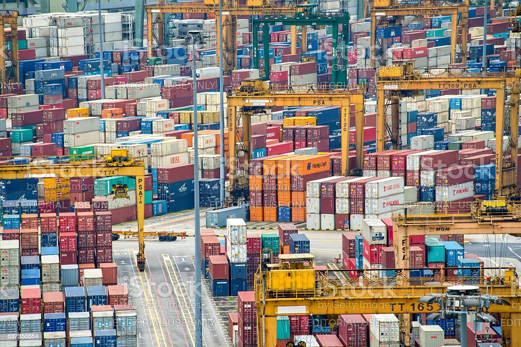 Piles of containers in the harbor of Singapore stock photo