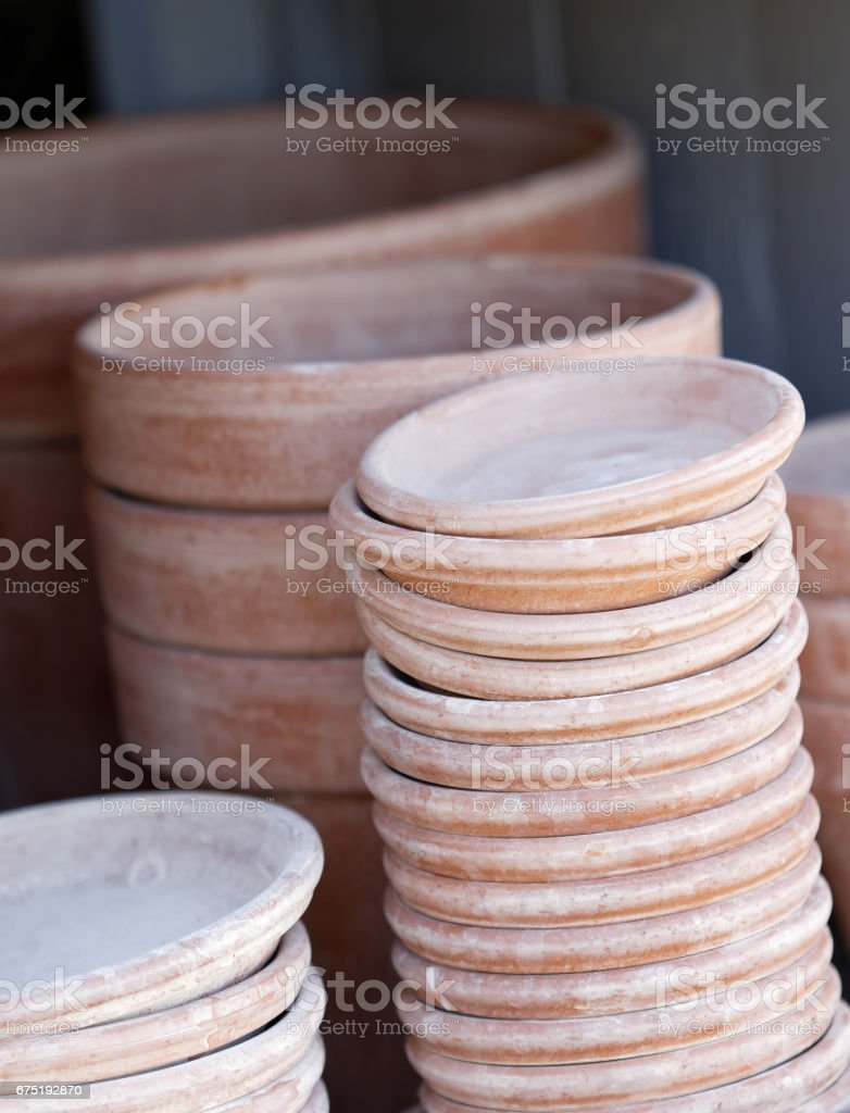 Piles of crocks made of terracotta used by the gardener stock photo