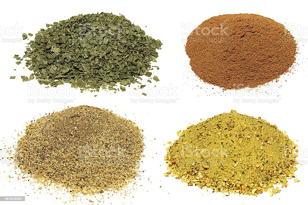 Piles of different spices  Isolated On White Background. stock photo