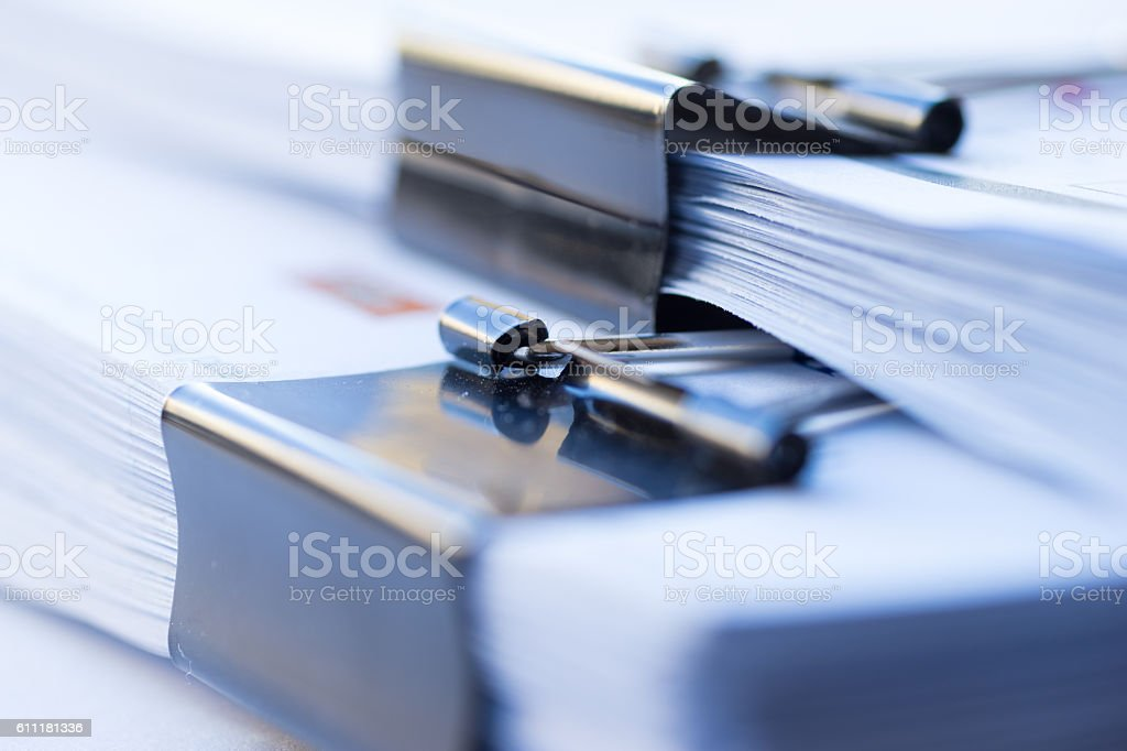 Piles of documents with black clip stock photo