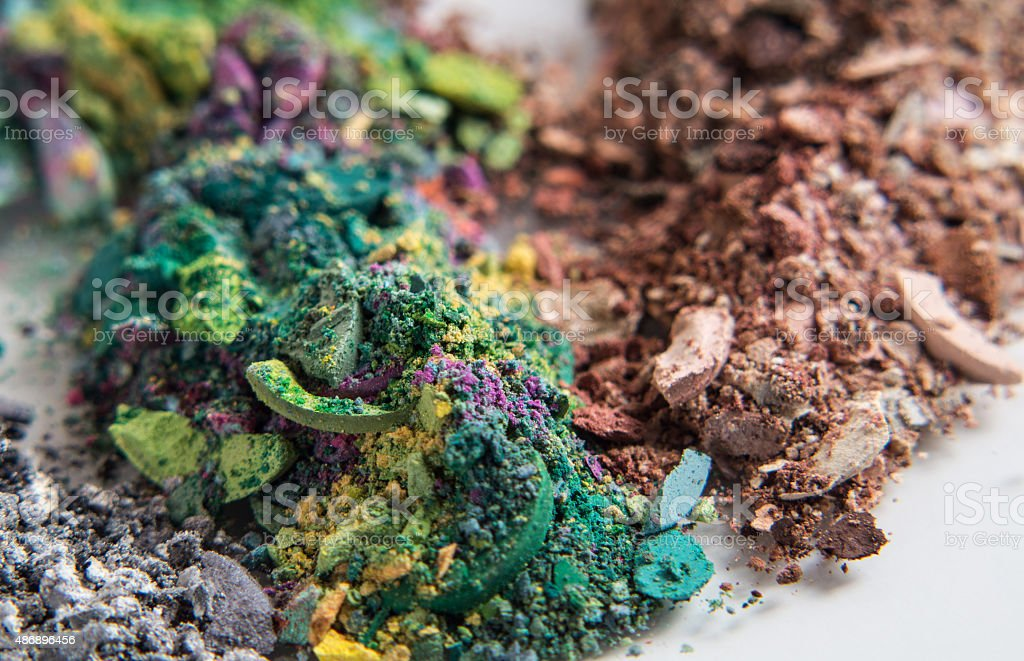 piles of eyeshadow crumbles in various colors stock photo
