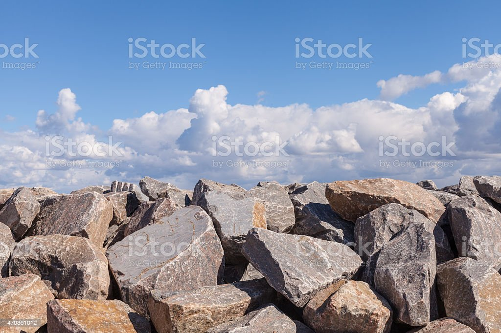 Piles of Gravel at Construction Site under Bright Blue Sky stock photo