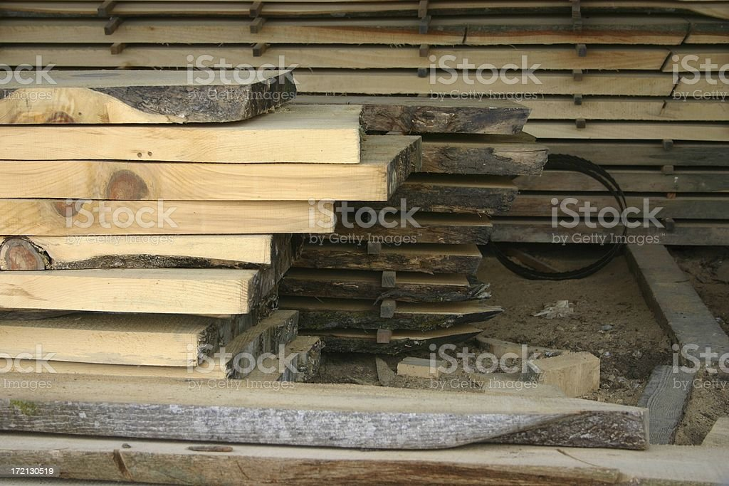 Piles of oak timber planks stock photo