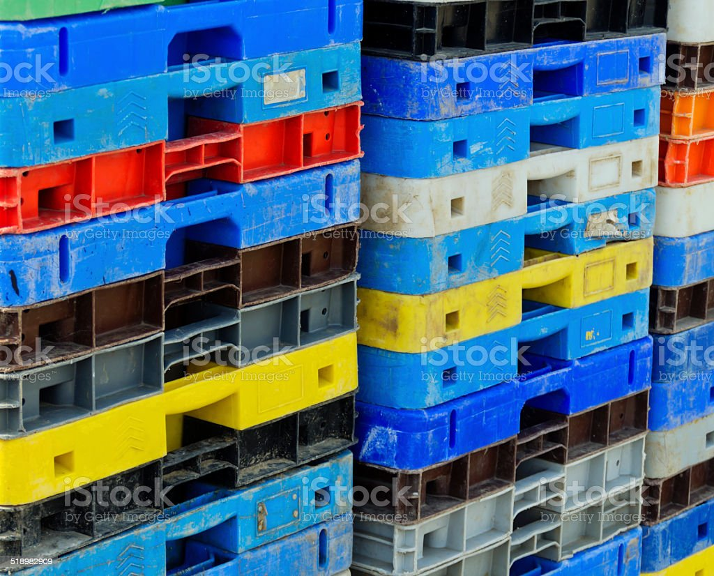 Piles of old fishing crates stock photo