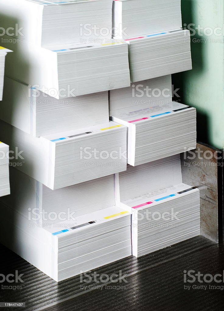 Piles of paper ready for trimming stock photo