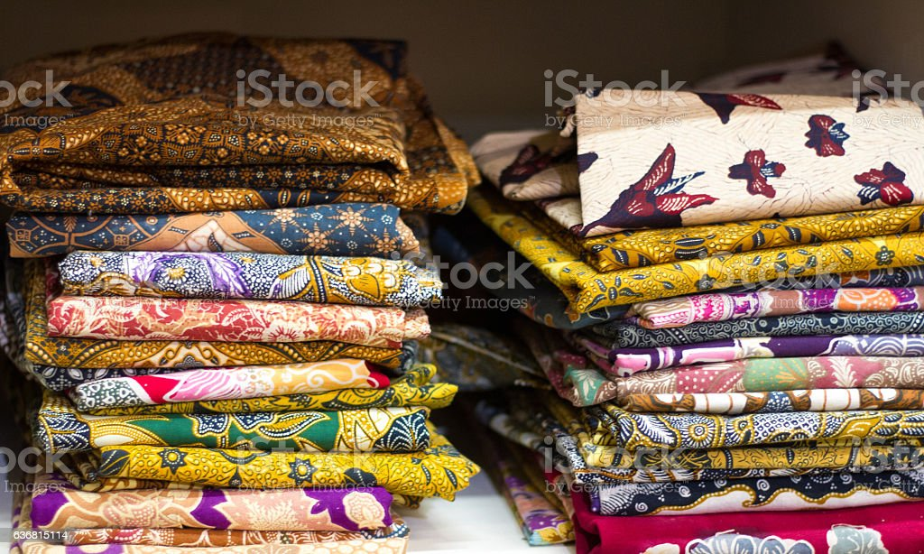 Piles of Printed Cotton African Fabrics/Textiles stock photo