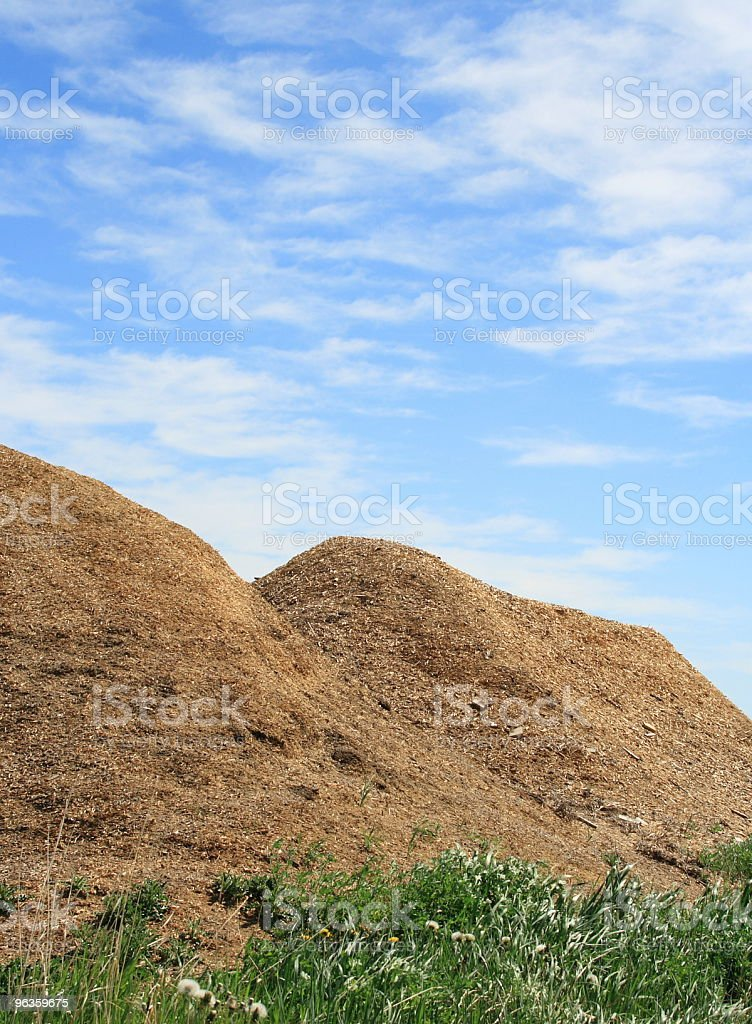 piles of sawdust after recycled pallets are ground up royalty-free stock photo
