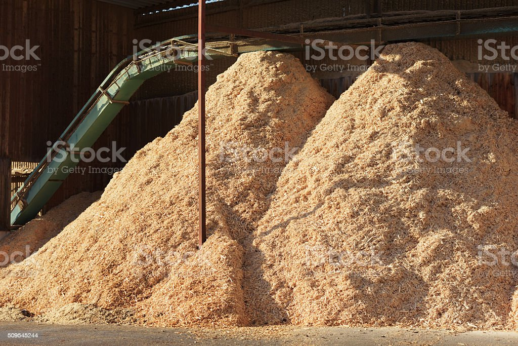 Piles of sawdust stock photo