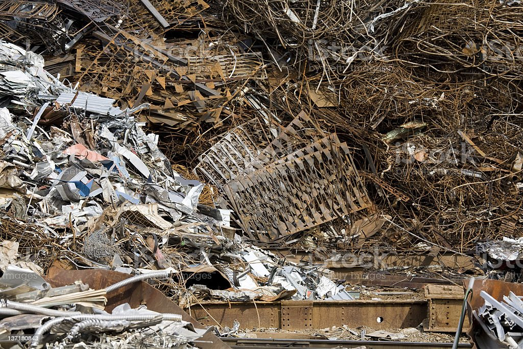 Piles of scrap metal for recycling and environmental conservation royalty-free stock photo
