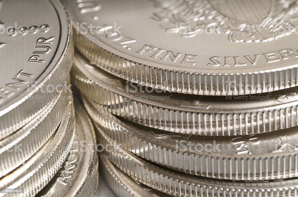 Piles of silver coins stock photo
