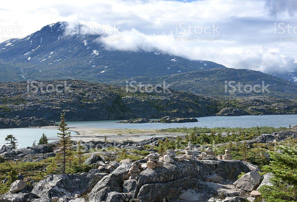 Piles of stones, art at glacier lake, Klondike highway. stock photo