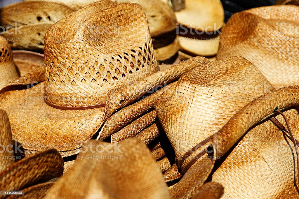 Piles of straw cowboy hats stock photo