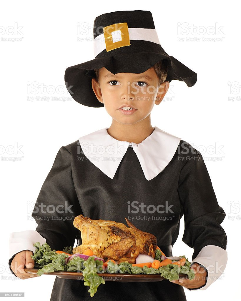 Pilgrim Boy Serving the Thanksgiving Feast stock photo