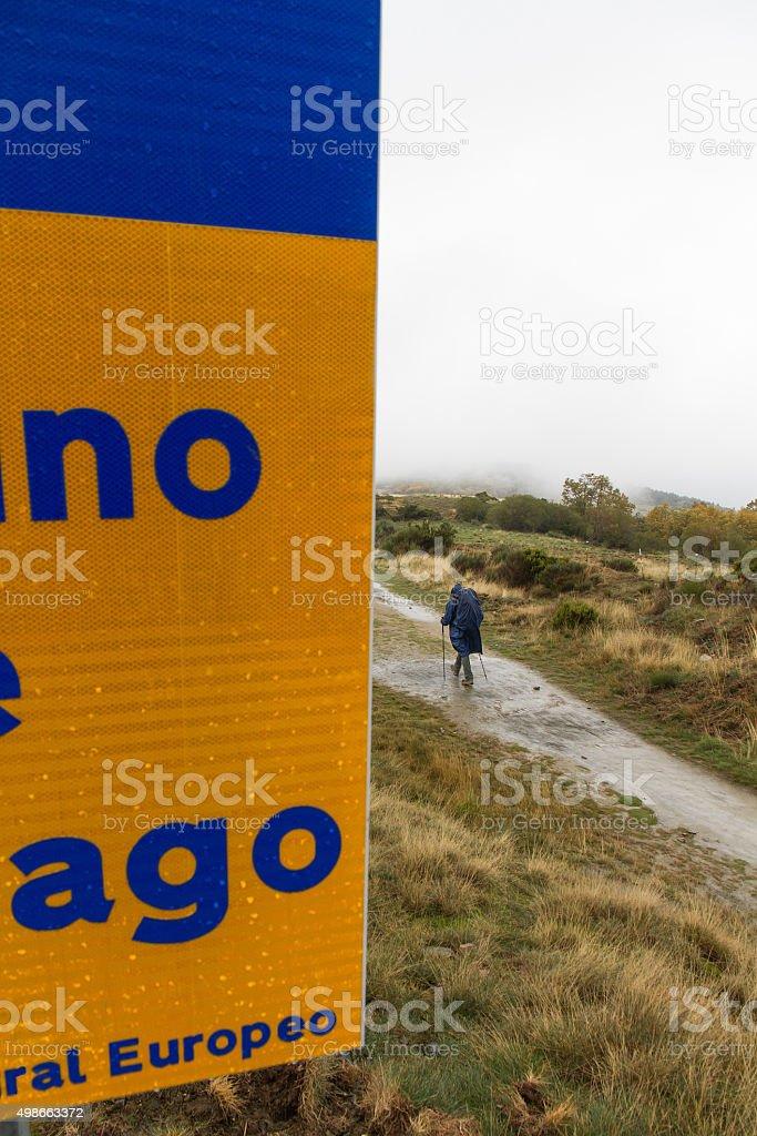 Pilgrim on the Camino de Santiago a rainy day stock photo