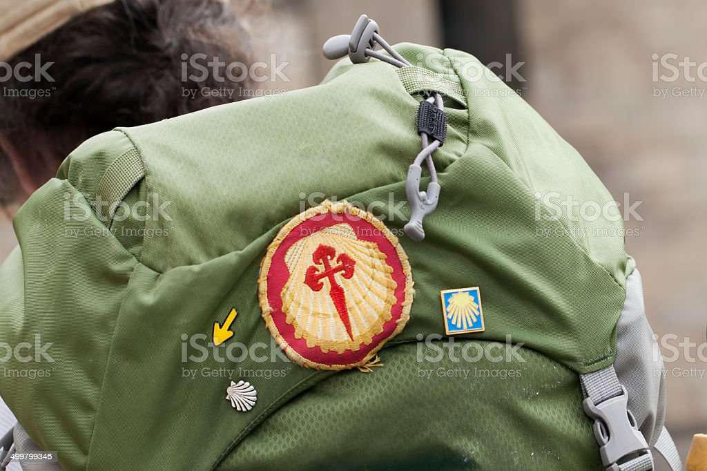 Pilgrim with rucksack and symbols of the 'camino de Santiago' stock photo