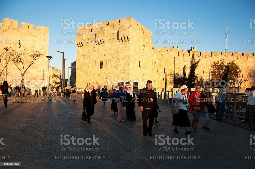 Pilgrim Women  going out from the Old City of Jerusalem. stock photo