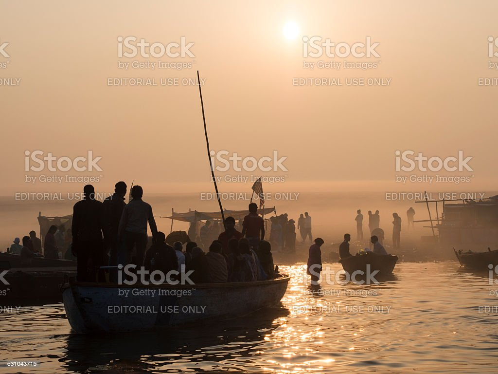 Pilgrims Approaching the East Bank of the Ganges in Varanasi, India stock photo
