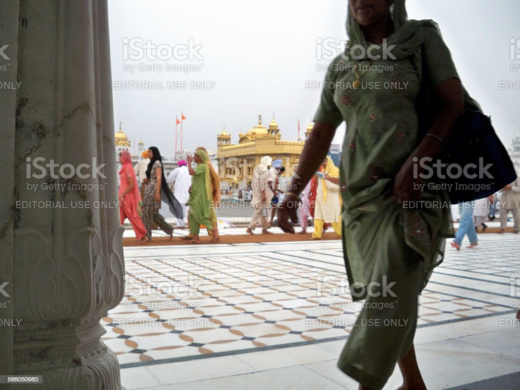 Pilgrims at Golden Temple in Amritsar stock photo