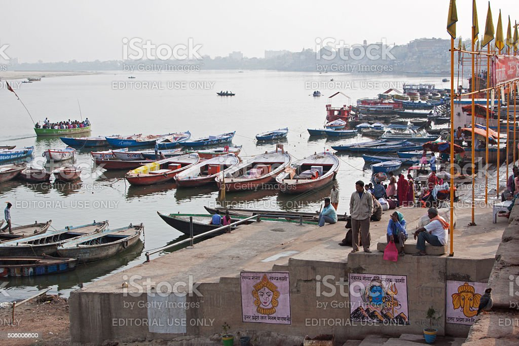 Pilgrims, bathers and boats on the banks of the Ganges stock photo