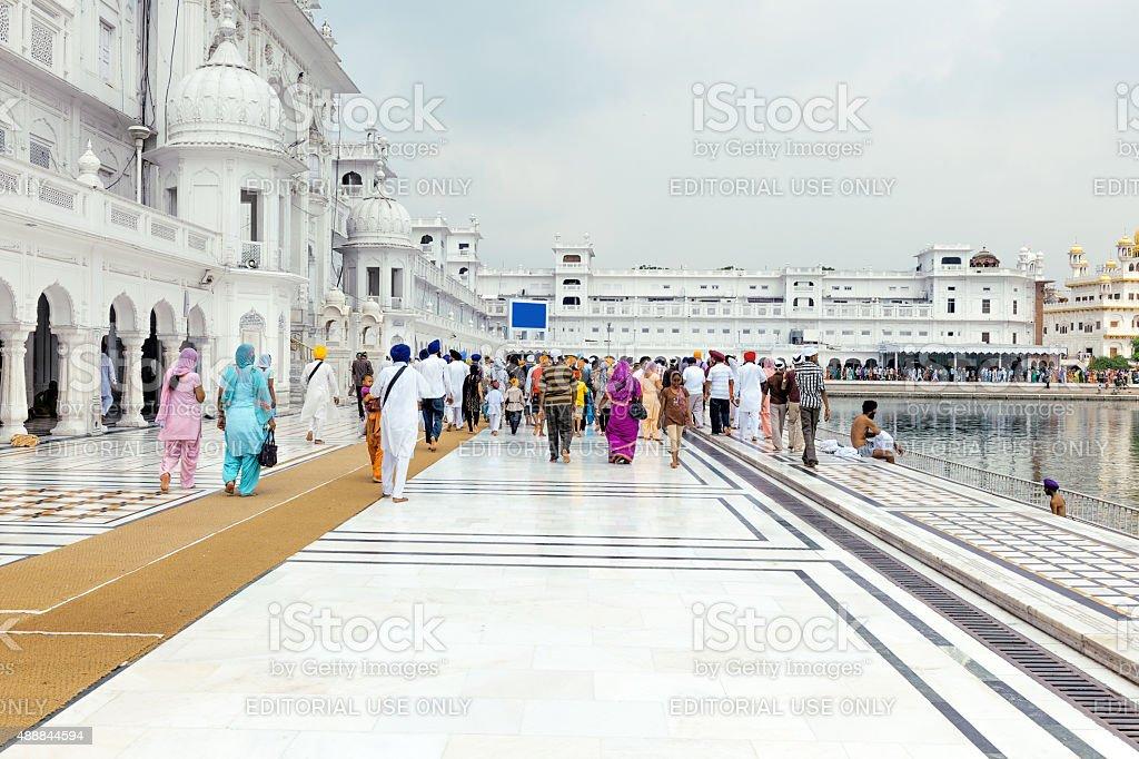 Pilgrims in Golden Temple Amritsar Punjab India stock photo