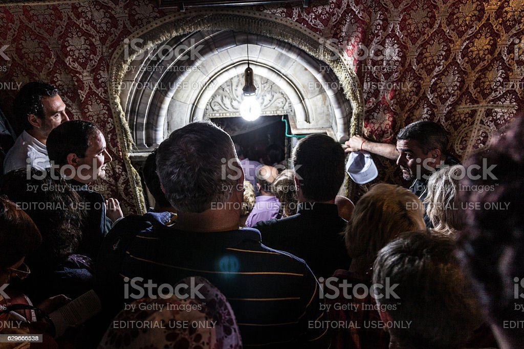 Pilgrims in Nativity Church in Bathlehem stock photo