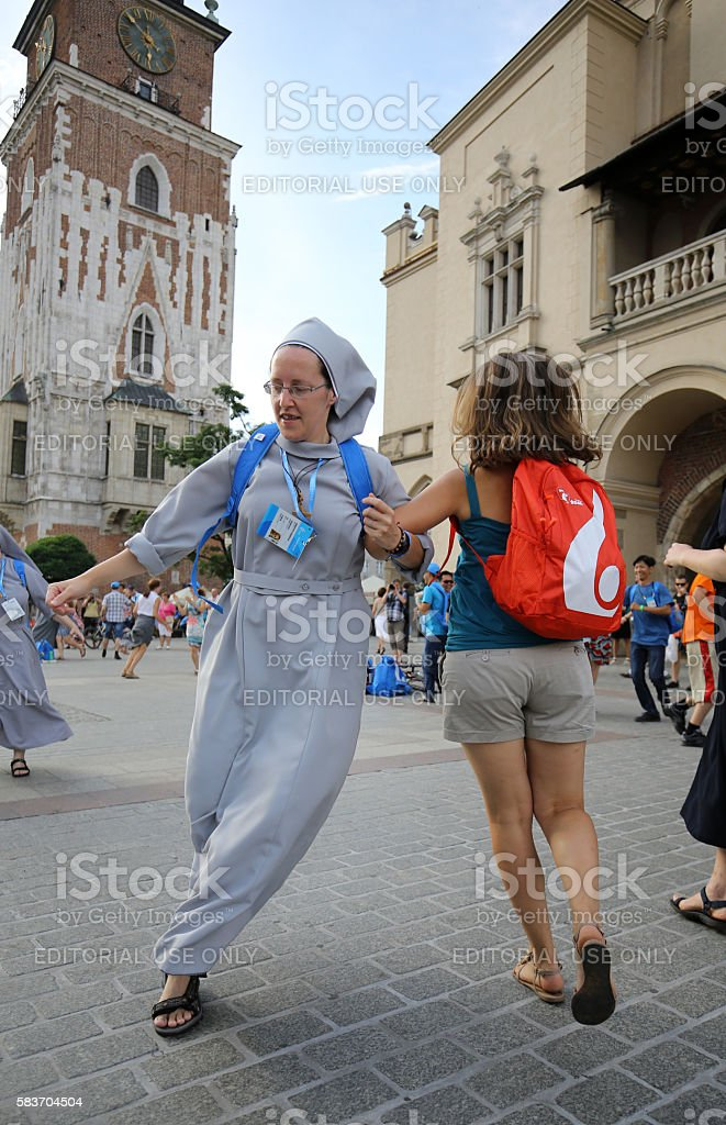 Pilgrims of WYD  dance on the Main Square in  Cracow stock photo