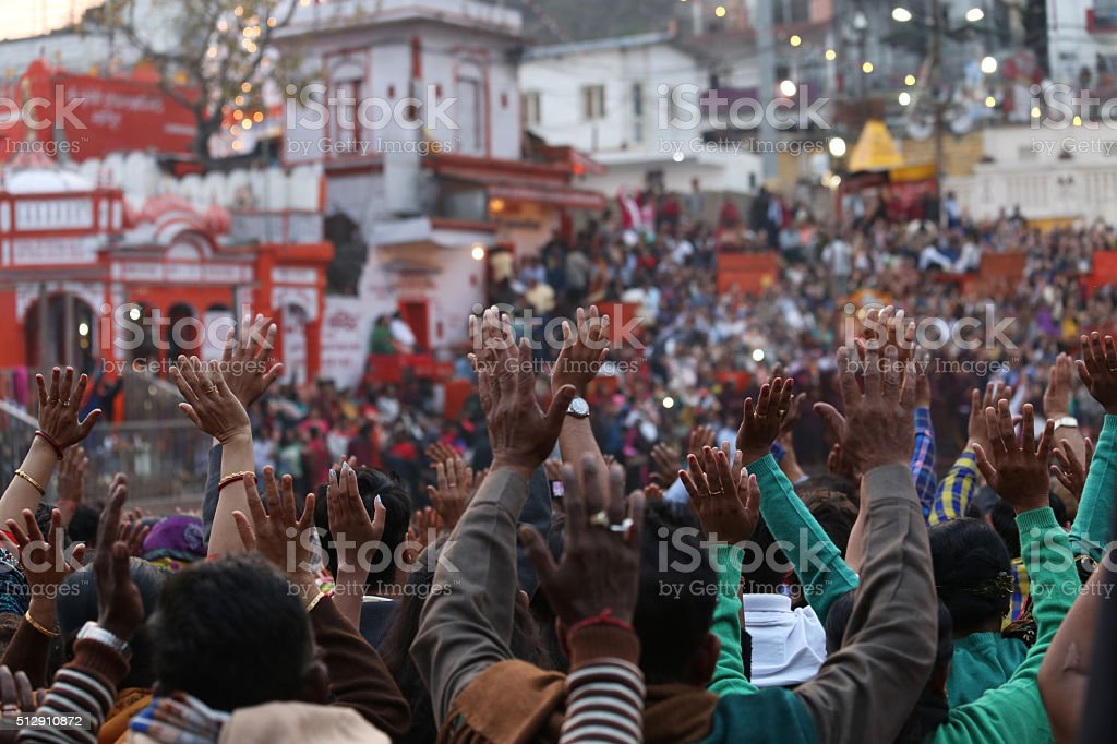 Pilgrims praying during Ganga Aarti at Har Ki Pauri stock photo