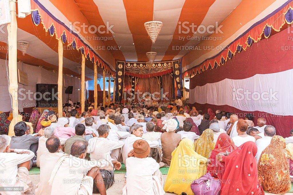 Pilgrims praying in a tent during Kumbh Mela stock photo