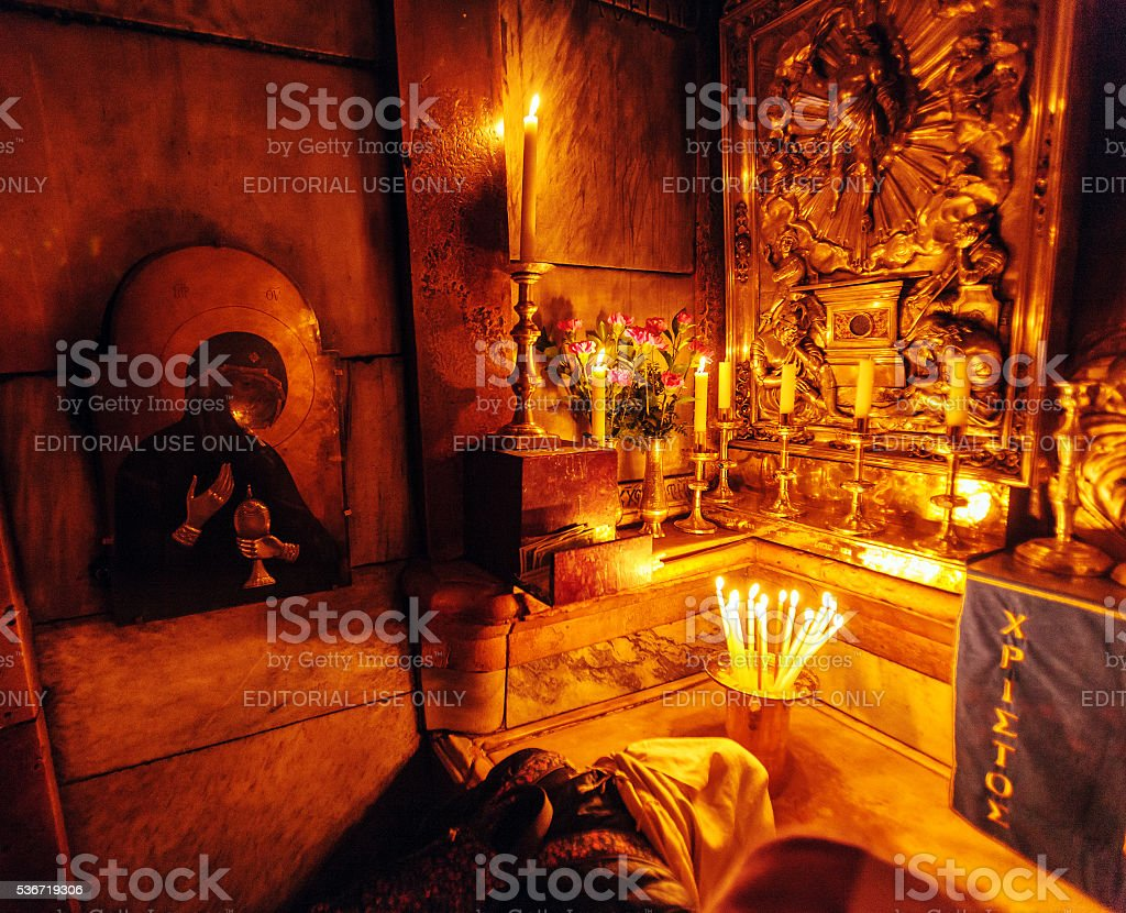 Pilgrims  praying inside Aedicule stock photo