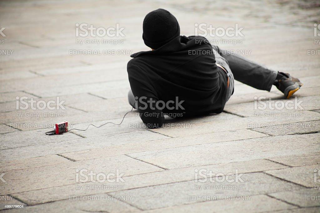 Pilgrims resting in Obradoiro square, Santiago de Compostela, Spain. stock photo