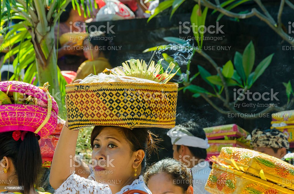 Pilgrims waiting at a temple ceremony in Bali - Indonesia stock photo