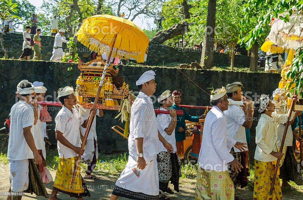Pilgrims with holy shrine walking to temple in Bali Indonesia stock photo