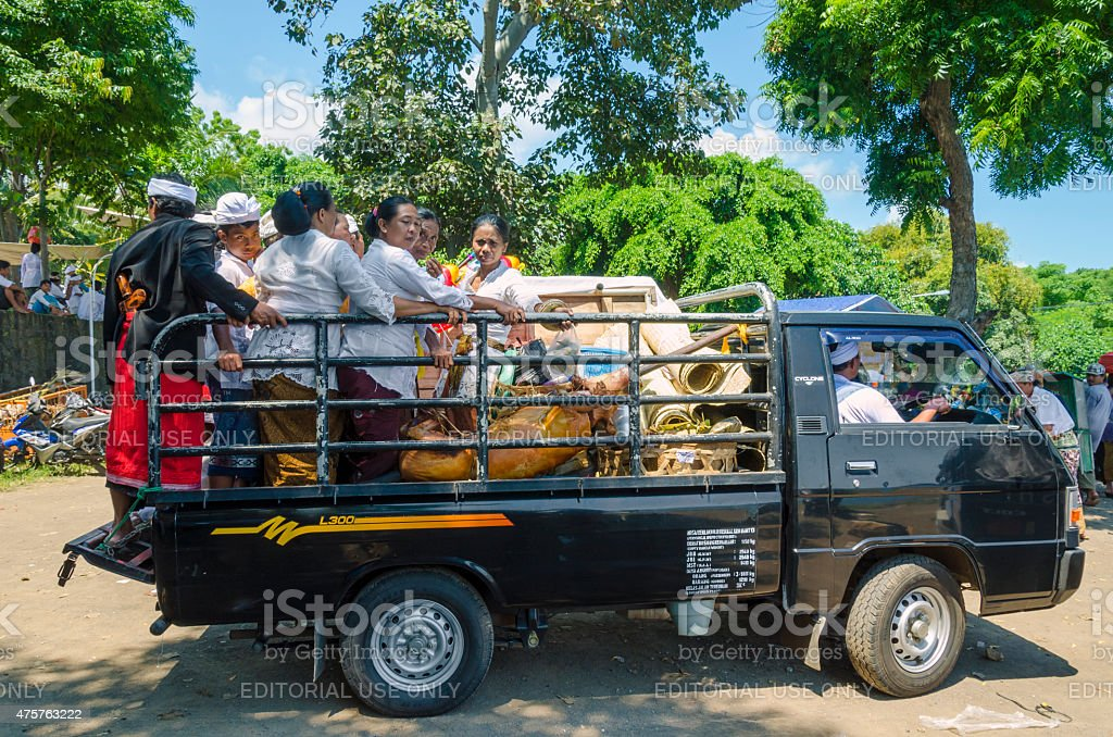 Pilgrims with roast suckling pig blessed by priest - Bali stock photo