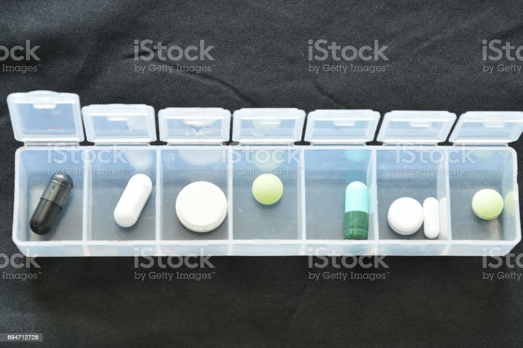 pill and capsule in plastic box stock photo