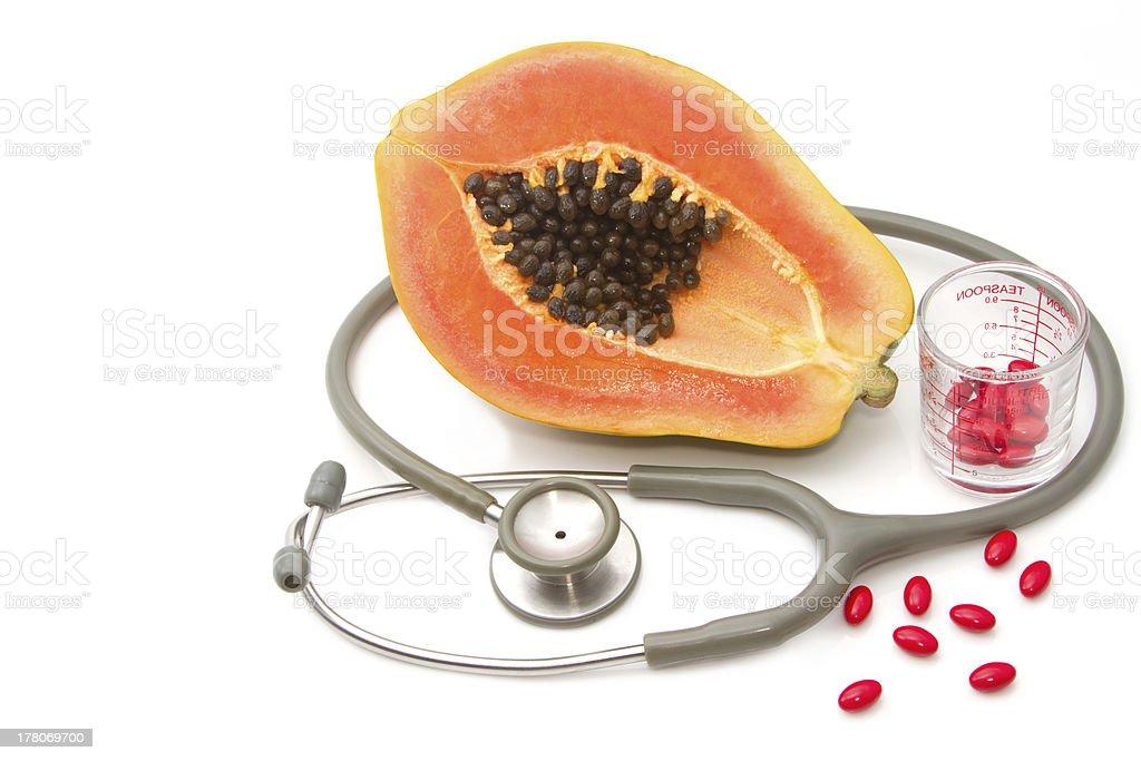 Pill and stethoscope with papaya fruit royalty-free stock photo