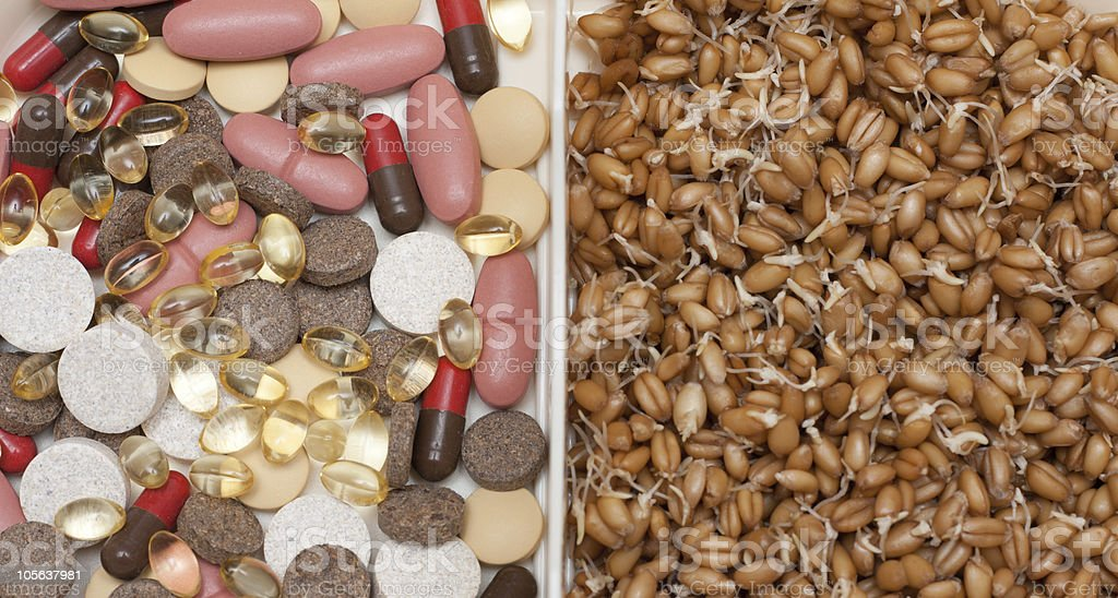 Pill and tablet vs wheat royalty-free stock photo