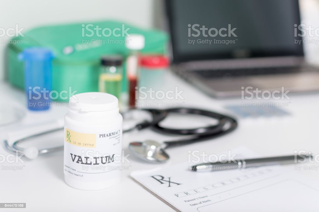 Pill bottle on a doctor's desk with Valium stock photo