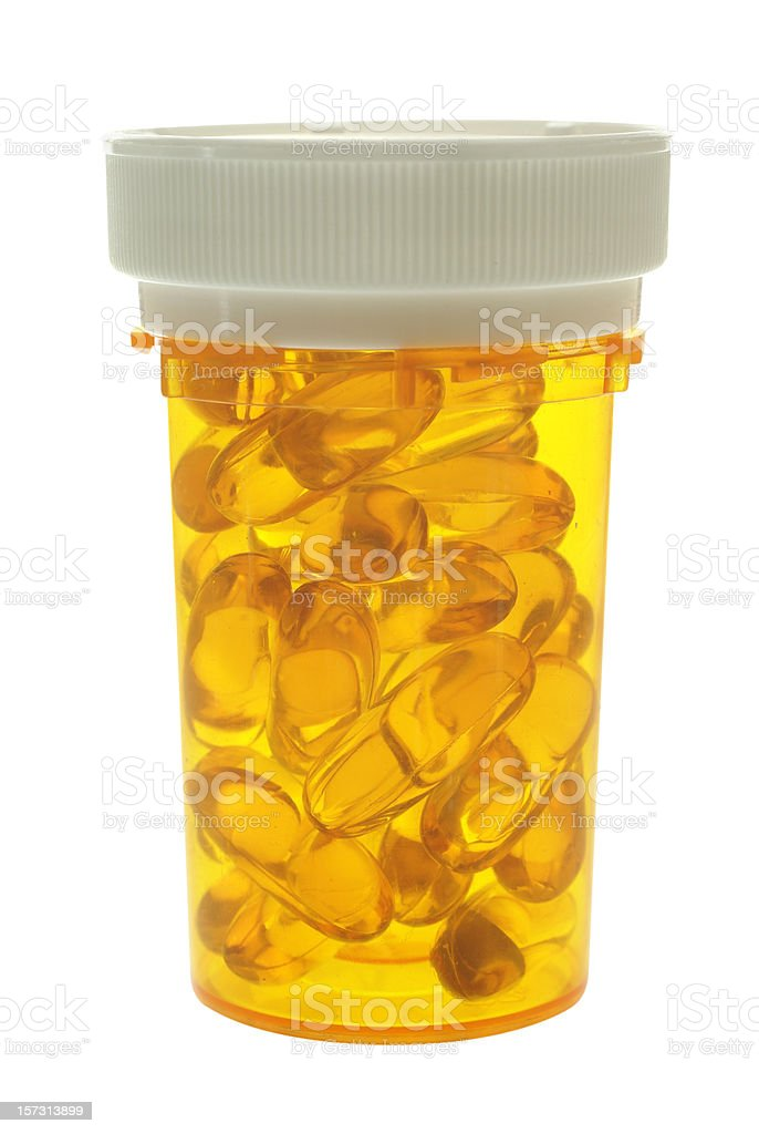 pill bottle with capsules royalty-free stock photo