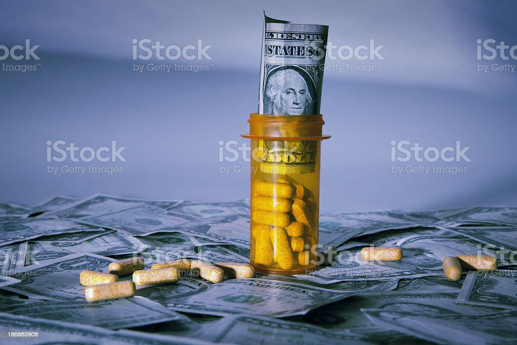 Pill Bottle with US Dollar royalty-free stock photo