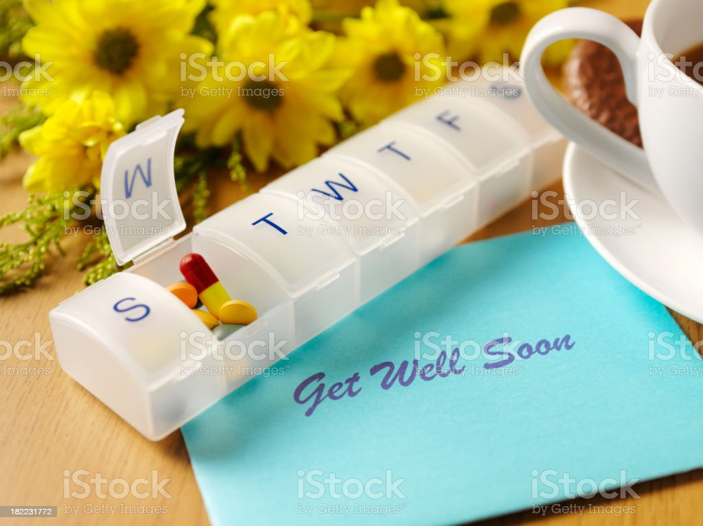 Pill Box, Flowers and Get Well Card royalty-free stock photo