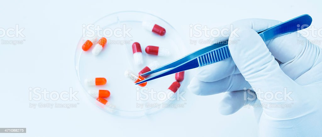 Pill capsules in container royalty-free stock photo