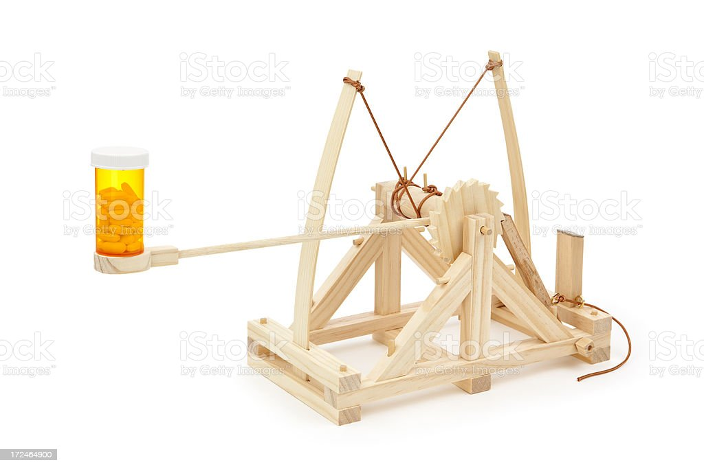 Pill Catapult Concept royalty-free stock photo