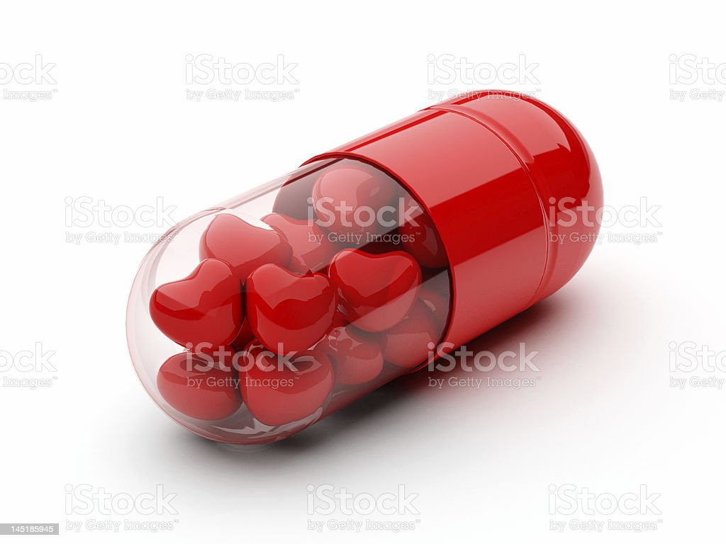 pill filled with hearts stock photo