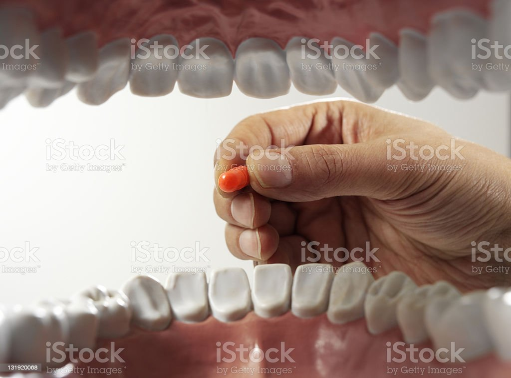pill in mouth stock photo