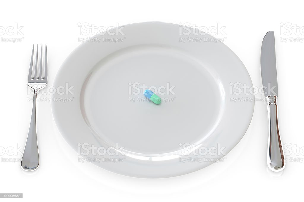 Pill in plate isolated over a white background. royalty-free stock photo