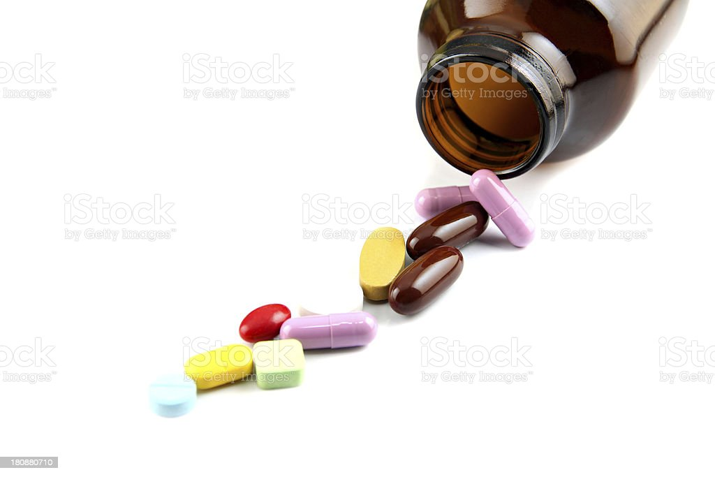 Pill of many color Beside the bottle. royalty-free stock photo
