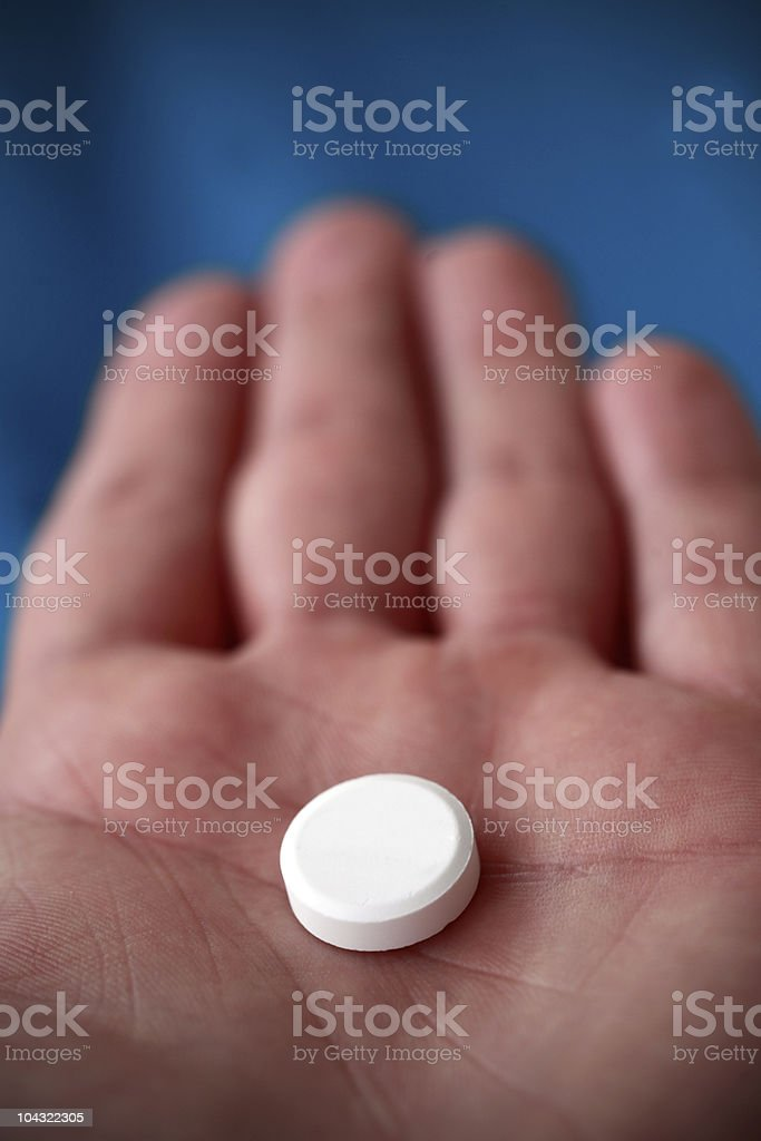 Pill on hand royalty-free stock photo